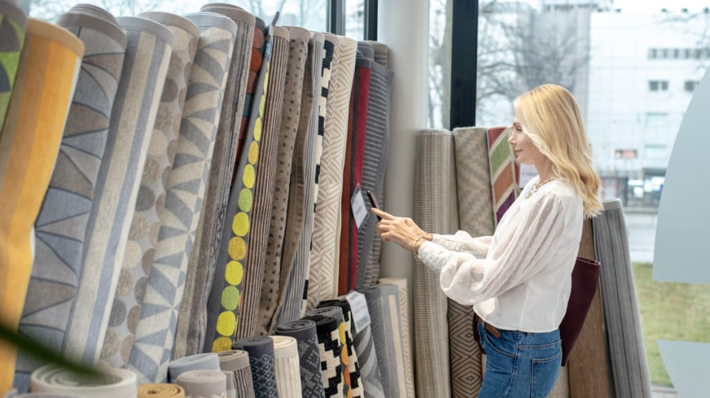 lady looking at area rugs